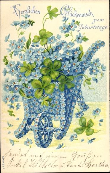 Präge Litho Glückwunsch Geburtstag, Schubkarre aus Vergissmeinnichtblüten, Kleeblätter