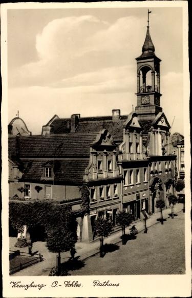 Ak Kluczbork Kreuzburg Oberschlesien, Rathaus, G. Georg Nitschke, Läden, Straßenansicht