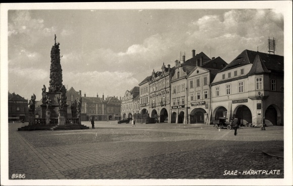 Ak Žatec Saaz Reg. Aussig, Marktplatz, Denkmal, G. Carl Löwy & Co., G. Julius Meinl