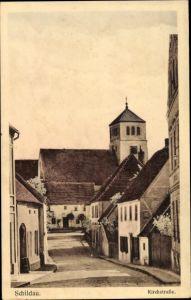 Ak Belgern Schildau in Nordsachsen, Kirchstraße mit Blick zur Kirche, Wohnhäuser