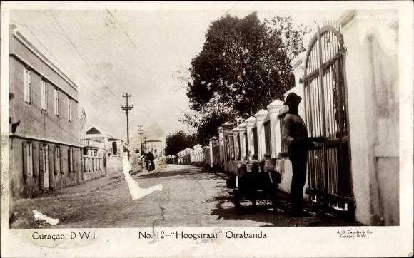 Ak Curacao, Hoogstraat Otrabanda, Mann am Tor, Fuhre, Wohnhäuser