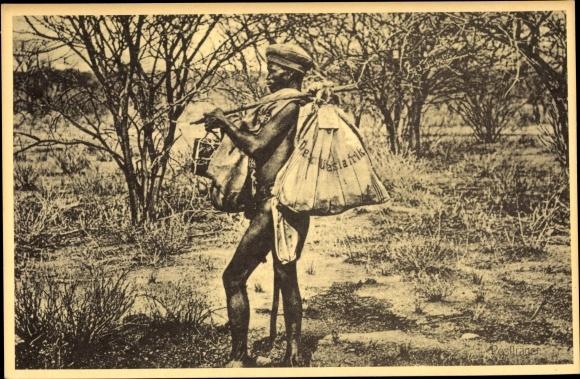 Ak Namibia Deutsch Südwestafrika, Einheimischer, Sack m. Aufdruck Deutsch Südwestafrika