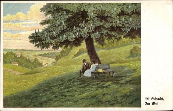 Künstler Ak Schacht, W., Im Mai, Mann und Frau auf einer Baumbank unter einem Kastanienbaum