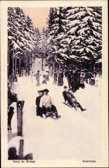 Ak Harz im Winter, Rodelbahn, Menschen auf Schlitten