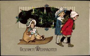 Ak Frohe Weihnachten, Schlitten, Mädchen, Tannenbaum, Kerzen