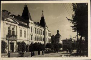 Ak Šluknov Schluckenau Region Aussig, Bahnhofstraße, Bürgerschule, Kolonialwaren Heinrich Beeß