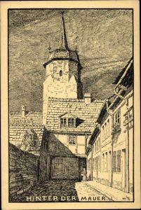Künstler Ak Theuerjahr, M., Köthen in Anhalt, Partie hinter der Mauer, Turm, Frau mit Korb