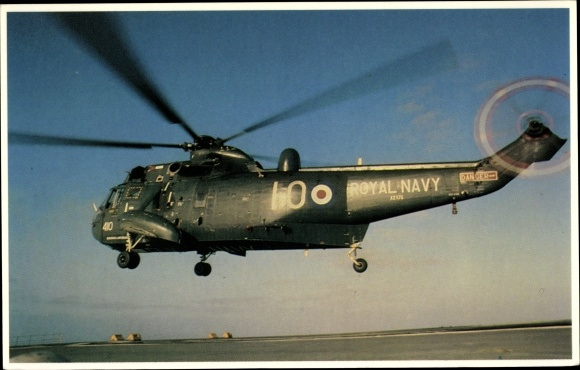 Ak A Sea King Helicopter approaches the landing pad, Royal Navy