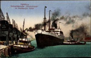 Ak Hamburg, Schnelldampfer Deutschland im Hafen, HAPAG, Schlepper Brunshausen