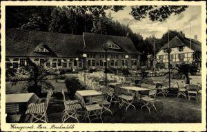 Ak Wernigerode am Harz, Harz. Storchmühle, Außenansicht, Gartentische u. Stühle, Laternen