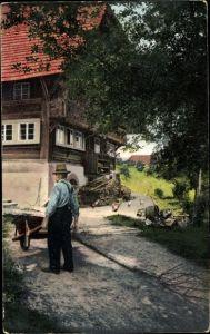 Ak Prinzbach Biberach Schwarzwald, Landhaus, Mann mit Schubkarre, Stimmungsbild