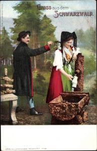 Ak Frau am Brunnen, Mann, Schwarzwälder Volkstrachten