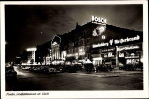 Ak Berlin Charlottenburg, Kurfürstendamm bei Nacht, Hotel am Zoo, Haus Wien, BOSCH Werbung, Autos