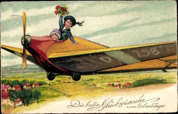 Ak Glückwunsch Geburtstag, Kinder im Flugzeug, Blumenstrauß