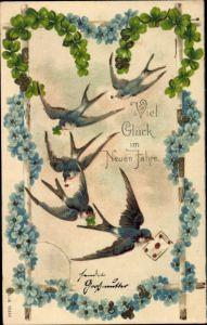 Präge Ak Glückwunsch Neujahr, Kleeblätter, Hufeisen, Schwalben