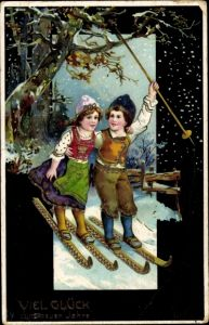 Präge Ak Glückwunsch Neujahr, Paar auf Skiern