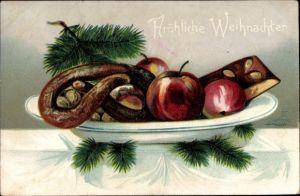Präge Litho Frohe Weihnachten, Gabenteller, Lebkuchen, Tannenzweig, Brezel, Äpfel