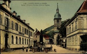 Ak Sainte Croix aux Mines Elsaß Bas Rhin, Église, Écoles et Fontaine, Rue de l'Église