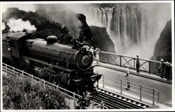Ak Rhodesien Simbabwe, A Rhodesian Railways' Train crossing the Victoria Falls Bridge