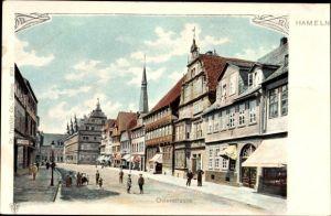 Ak Hameln in Niedersachsen, Blick in die Osterstraße, Passanten