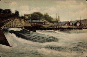 Ak Domnarvet Borlänge Schweden, Flusspartie mit Blick auf den Ort, Brücke, Wehr