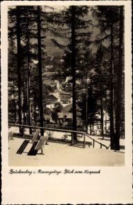 Ak Brückenberg b. Krummhübel Riesengebirge Schlesien, Blick vom Kurpark im Schnee