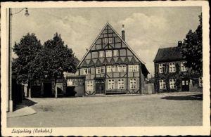 Ak Lütjenburg in Schleswig Holstein, Platz, Fachwerkhaus
