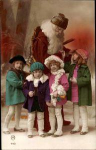 Ak Frohe Weihnachten, Weihnachtsmann, Kinder, Geschenke