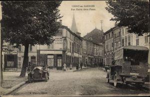 Ak Ligny en Barrois Meuse, Rue Entre deux Ponts, voitures