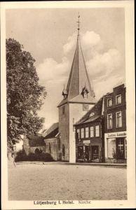 Ak Lütjenburg in Schleswig Holstein, Blick auf die Kirche, Straßenpartie im Ort
