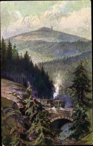 Künstler Ak Brockenbahn an Brücke, Brocken im Hintergrund