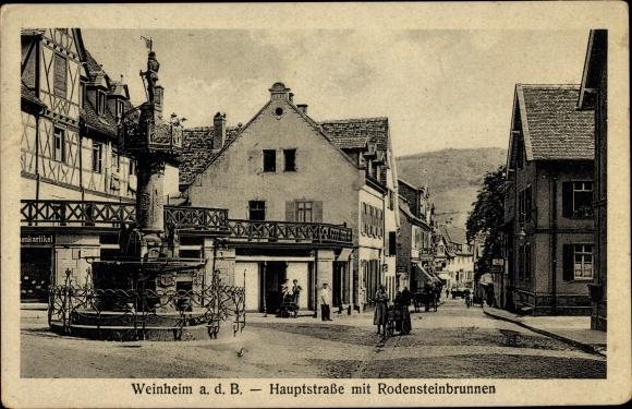Ak Weinheim an der Bergstraße Baden, Hauptstraße mit Rodensteinbrunnen, Geschäfte