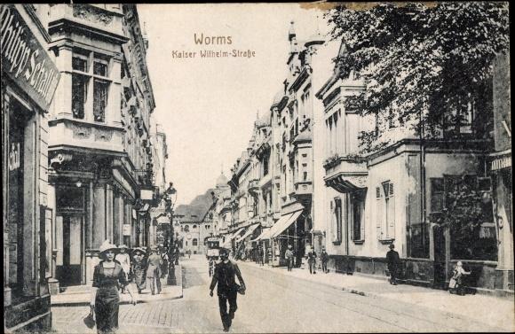 Ak Worms in Rheinland Pfalz, Kaiser Wilhelm Straße, Geschäft Philipp Schall, Passanten, Straßenbahn