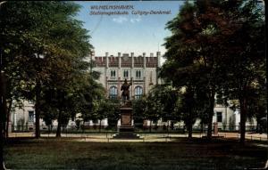 Ak Wilhelmshaven in Niedersachsen, Stationsgebäude, Coligny Denkmal