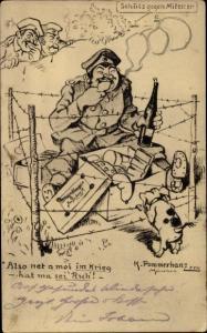 Künstler Ak Pommerhanz, K., Soldat isst hinter Stacheldrahtzaun, Soldatenhumor