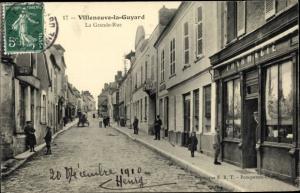 Ak Villeneuve la Guyard Yonne, La Grande Rue, Pharmacie