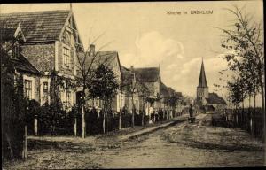Ak Breklum in Nordfriesland, Kirche, Straßenpartie