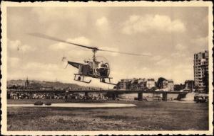Ak Liège Lüttich Wallonien, Helikopter in der Luft, Brücke