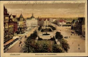 Ak Düsseldorf am Rhein, Wilhelmplatz mit Hauptbahnhof, Parkanlage, Häuserfassaden