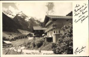 Ak Finkenberg in Tirol, Teilansicht vom Ort, Häuser, Berglandschaft
