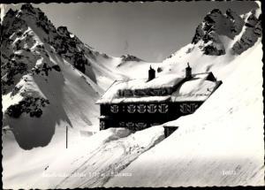 Ak Silvretta Tirol, Saarbücknerhütte, Außenansicht, Winterlandschaft