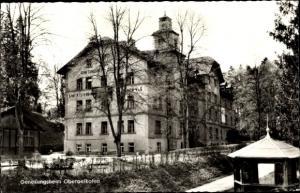 Ak Oberelkofen Grafing Oberbayern, Genesungsheim Oberölkofen, Gesamtansicht, Winterlandschaft
