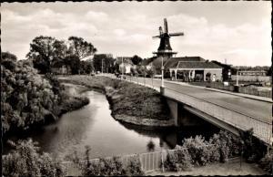 Ak Norden Ostfriesland, Deichmühle mit Mühlenbrücke