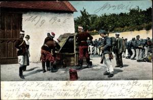 Ak Kuk Soldaten an einem Brunnen