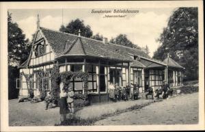 Ak Schledehausen Bissendorf in Niedersachsen, Sanatorium Schweizerhaus, Totalansicht, Menschen
