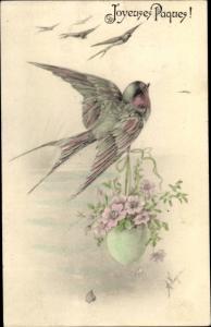 Künstler Ak Glückwunsch Ostern, Schwalbe mit Osterei, Blüten