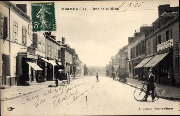 Ak Commentry Allier, rue de la Mine, cycliste 0
