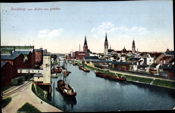 Ak Duisburg im Ruhrgebiet, Teilansicht der Stadt, Hafenpartie, Binnenschiffe vor Anker, Kirchtürme 0