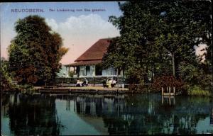 Ak Neudöbern Schöllnitz in der Niederlausitz, Lindenkrug vom See gesehen