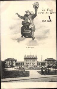 Ak Bad Elster im Vogtland, Kurhaus, Mann auf Koffer mit Blumenstrauß, Im Fluge durch die Welt